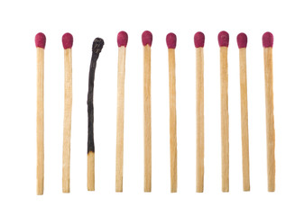 Matches on a row with one burned down.