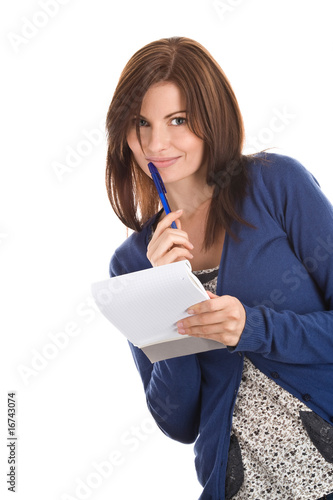 Young woman does records by pen in notepad