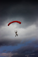 red parachute in the sky