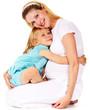girl hugging her pregnant mother