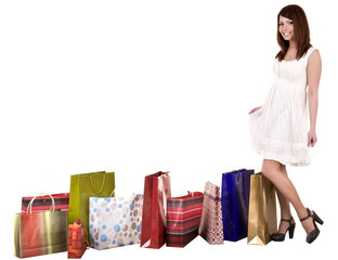 Girl with shopping bag wait for  taxi.Isolated.