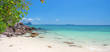 panoramic beach with white sand and tropical sea