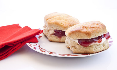 Home-baked scones with strawberry jam and clotted cream, often s