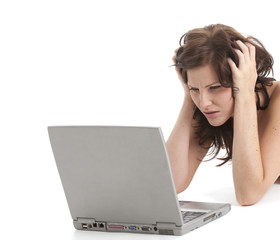 Beautiful brunette woman frustrated by crashing laptop