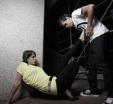 Woman on the ground kicking a man in the abdomen poster