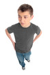 Boy in grey t-shirt and blue jeans hands on hips