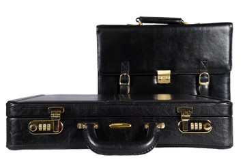 two black leather briefcases isolated with clipping path