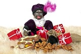 Zwarte Piet with presents and sweets at 5th december