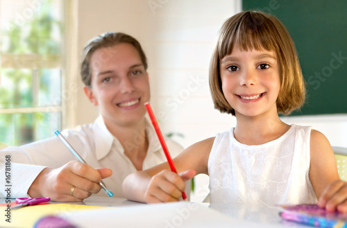 Elementary school pupil working with educator