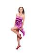 Young beautiful female wearing lilac dress, dancing