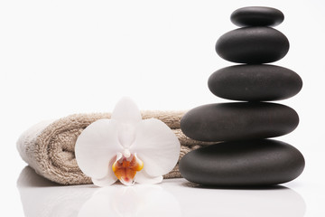 spa stones towel and orchid