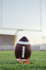 American football field goal attempt with ball on tee
