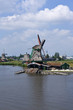 Dutch windmill on a canals edge