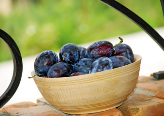 Plums wooden bowl