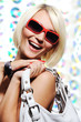happy beautiful woman with red sunglasses
