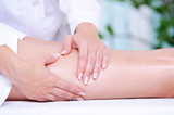 female leg getting massage by beautician poster