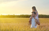 Father with his daughter in wheat field