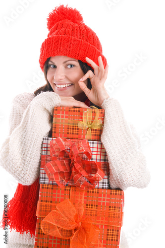Woman holding gifts indicated OK sign