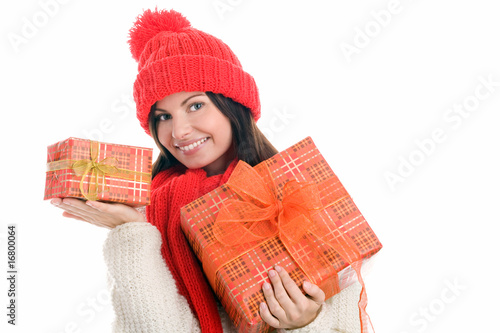 Young woman holding two gifts smiling