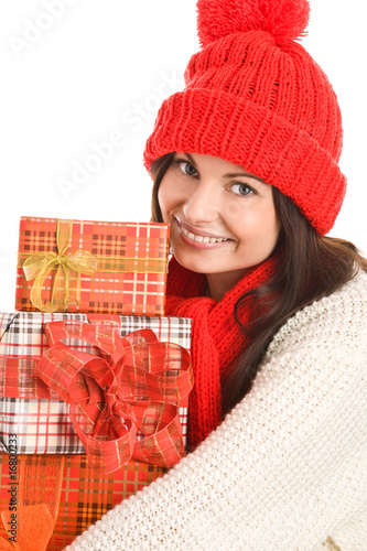 Pretty young woman with three gifts