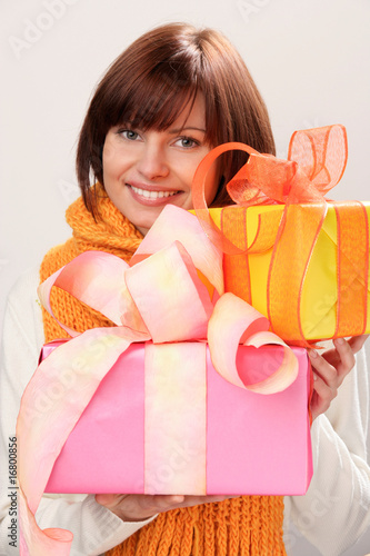Portrait of young woman holding gifts