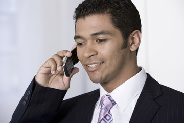 Portrait of businessman on phone.