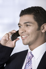Portrait of businessman on phone