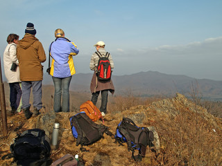 family of hiking people on the mountain top