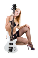 Sexual blonde and a white bass guitar