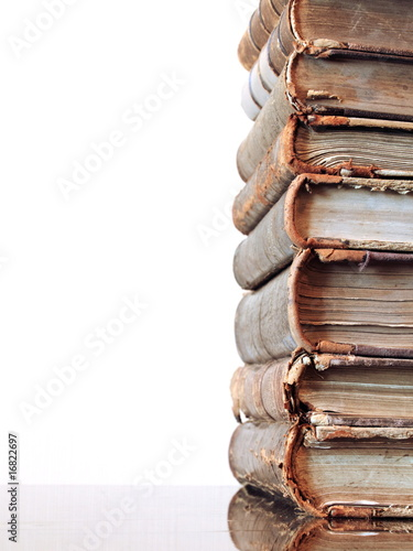 Pile of very old books on a white background