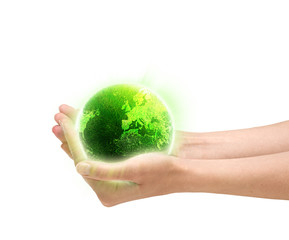 Human hands holding glowing green planet