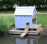 A Wooden Home and Shelter Made for Ducks. poster