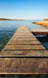Wooden pier in Greece extending into the sea