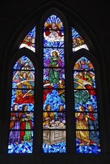 Church stained glass window with religious scenes