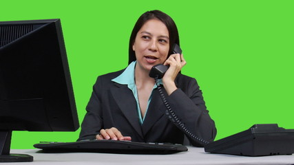 Supervisor talking on headset - green screen version