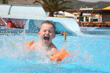 The child laps in an aquapark.