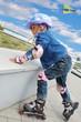 child on in-line skates