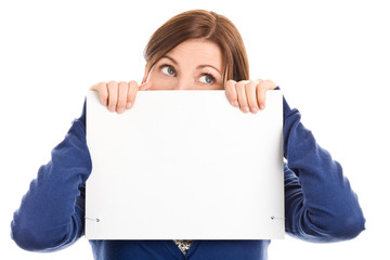 Worried woman covering face with blank notecard
