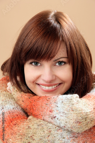Portrait of beautiful woman on brown background