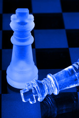 Chess men and chequered background.