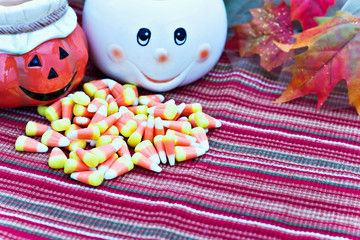 Cute ghost and jack o' lantern with Halloween candy.