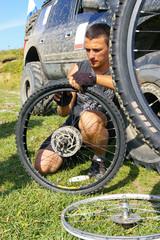 Bicyclist repairs wheel