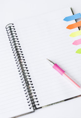 Lined spiral notepad with colorful sticky notes