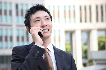 Businessman talks with a cellular phone