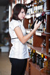 Young woman in wine shop