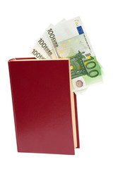 Money in book, isolated