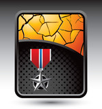 Military medal on gold cracked backdrop