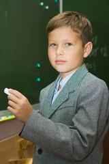 The pupil with a chalk at a school board