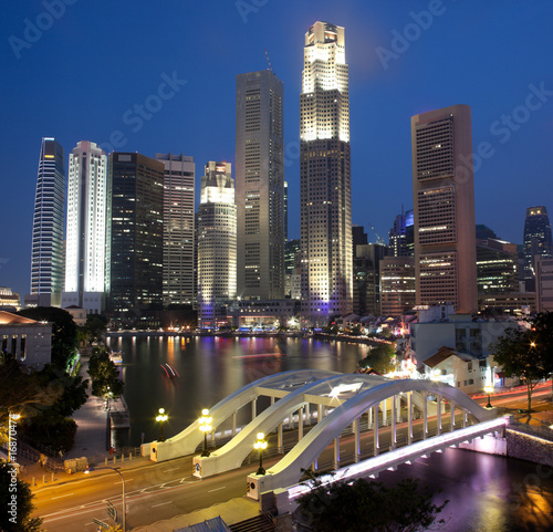 Singapore night scene framed by Elgin Bridge and River