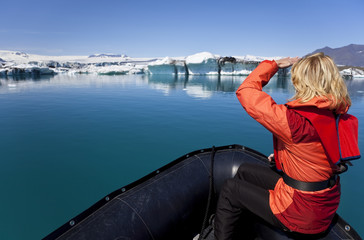Woman Explorer Using Boat in Iceberg Field, Jokulsarlon Lagoon,
